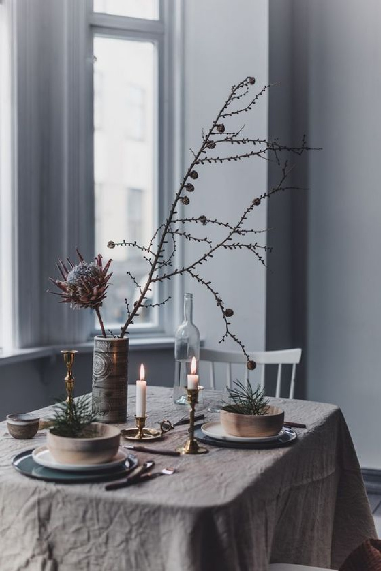 Pale Swedish Christmas tablescape with wrinkly tablecloth and rustic organic touches for a simple Scandinavian style holiday - Gunn Kristin Monsen.