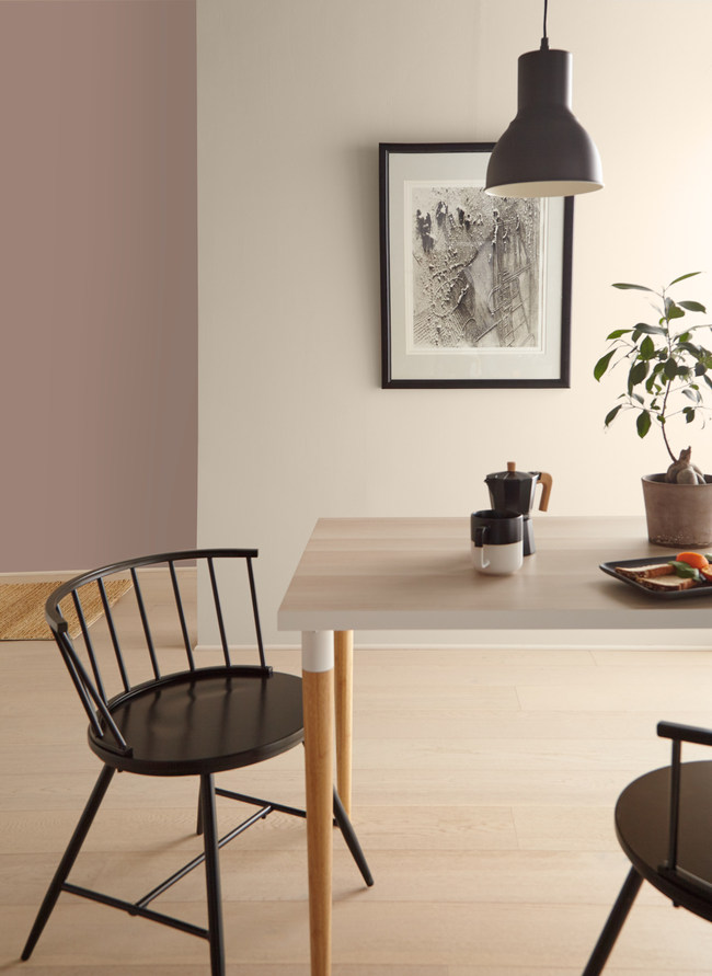 Almond Wisp (Behr paint color) on the wall of a dining room with Scandi decor. #behralmondwisp #almondwisp #paintcolors
