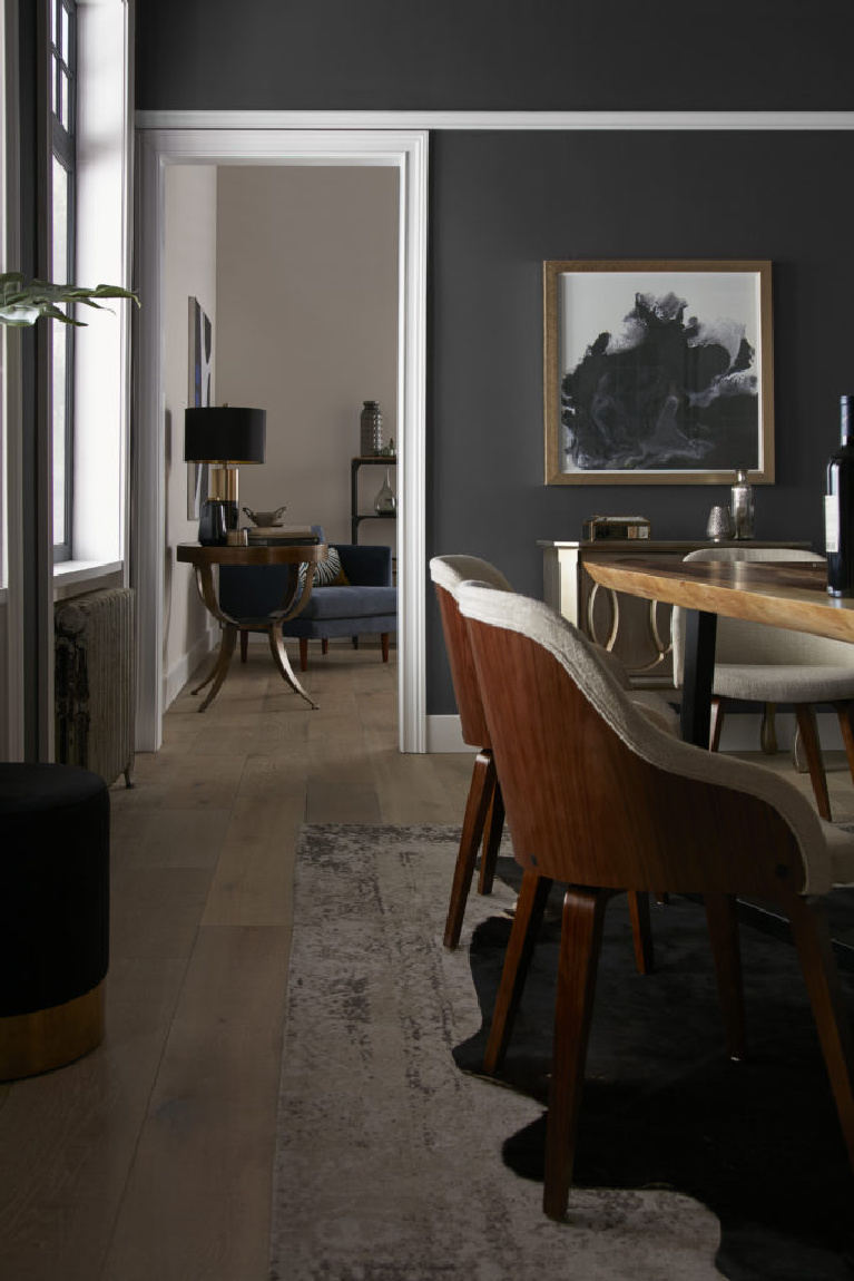 Behr Broadway paint color in a dining room is a deep dark bronzy soft black-brown for a bit of drama for your walls. Discover inspiring understated neutrals to try in your own home. #behrbroadway #paintcolors #blackpaints