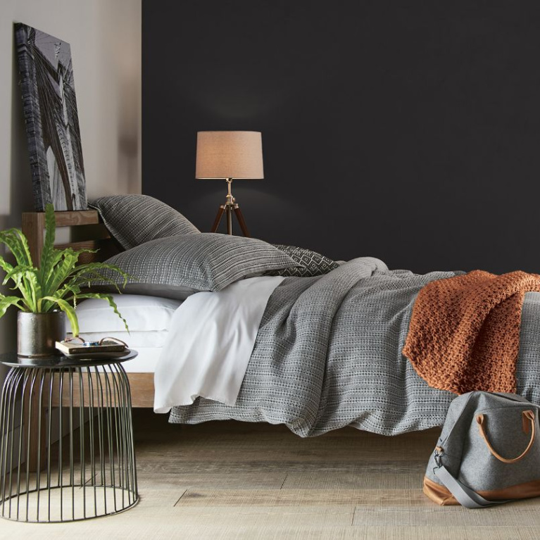 Behr Broadway paint color in a bedroom is a deep dark bronzy soft black-brown for a bit of drama for your walls. Discover inspiring understated neutrals to try in your own home. #behrbroadway #paintcolors #blackpaints