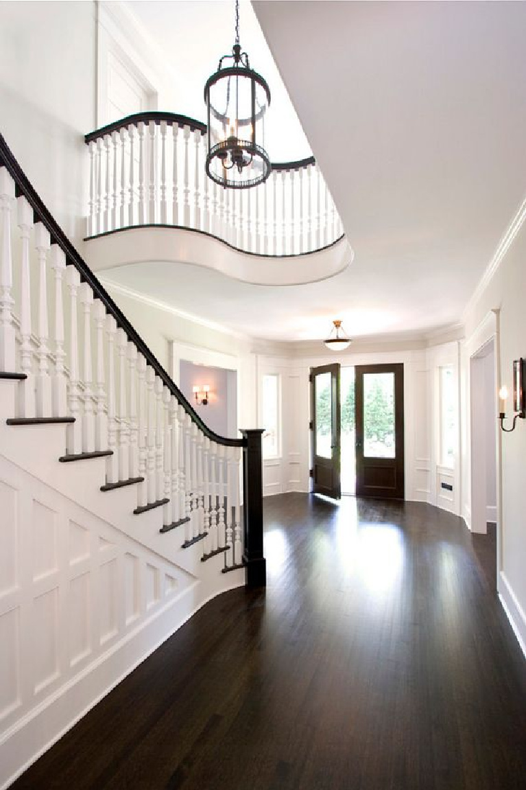 Benjamin Moore Atrium White paint color on walls of an elegant French country entry with staircase. #atriumwhite #benjaminmooreatriumwhite #paintcolors