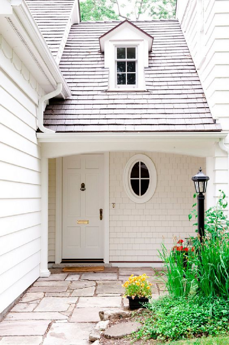Front door painted Atrium White (Benjamin Moore) for this gorgeous classic traditional home exterior. Discover inspiring understated neutrals to try in your own home. #atriumwhite #paintcolors #frontdoor #benjaminmooreatriumwhite #paintcolors