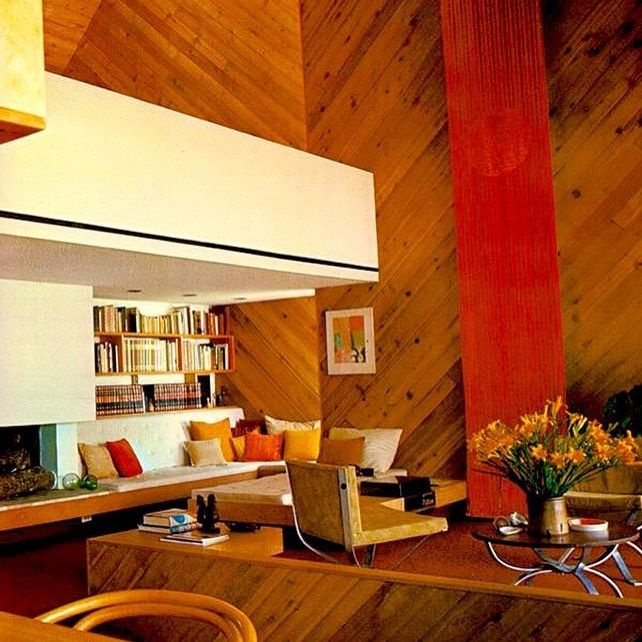 Funky 1980s family room with lofty ceiling, wood paneling installed on diagonal, and earth tones - @jenniferthenc_realtor