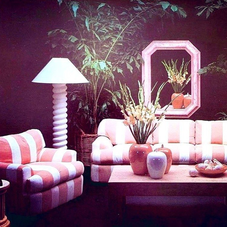 1980s decorated living room with mauve stripe sofa and chair, geometric mirror, and houseplants - @jenniferthenc_realtor
