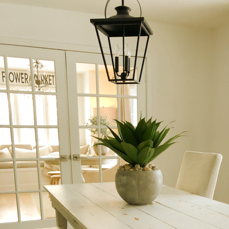 "Simple spare and natural dining room with farm table and 24"" artificial agave potted succulent- Hello Lovely Studio."
