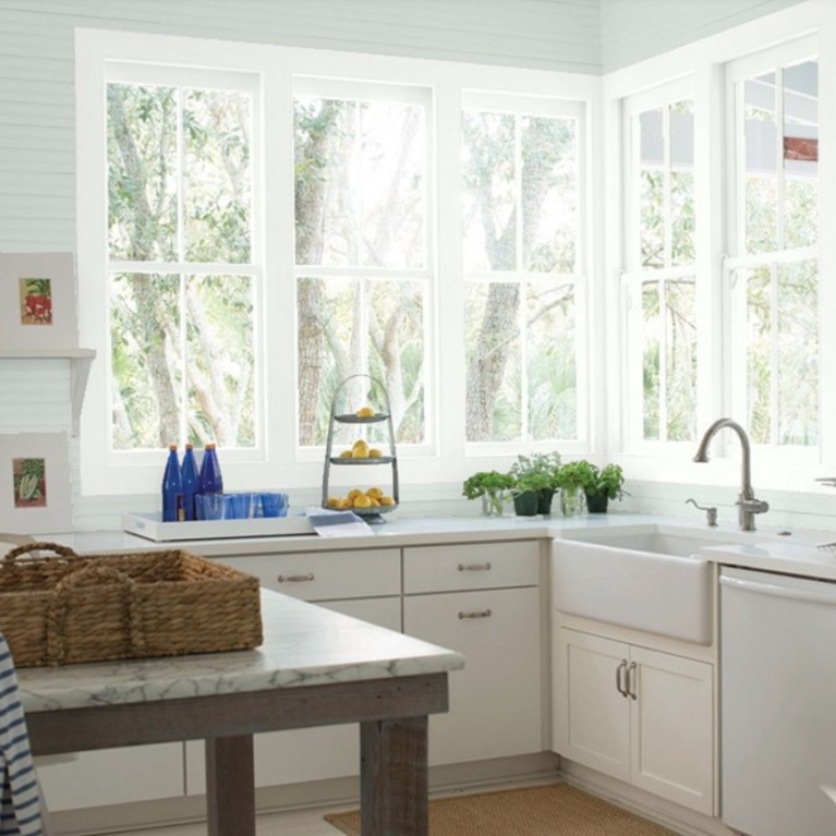 Modern farmhouse kitchen painted Quiet Moments (Benjamin Moore) with white cabinets painted Chantilly Lace. #quietmoments #paintcolors #chantillylace #kitchen #paleblue
