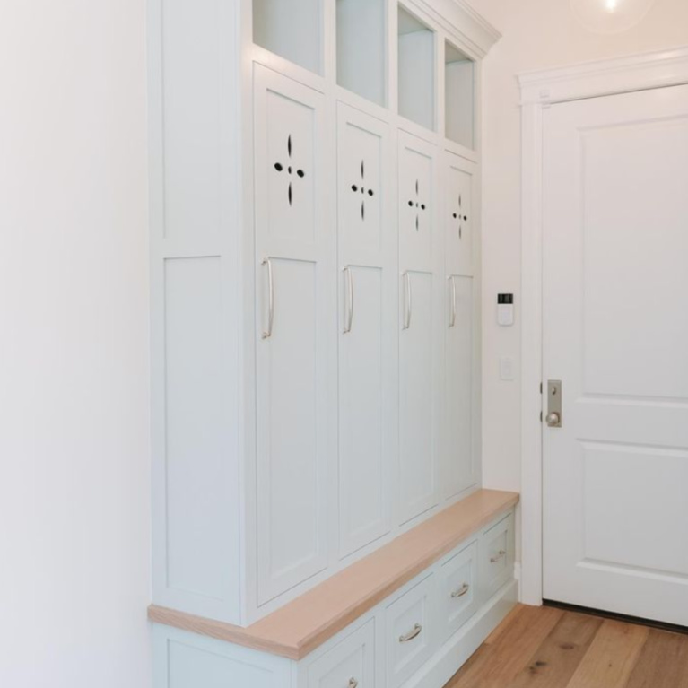 Quiet Moments pale blue pant color (Benjamin Moore) on mud room custom wood cabinet lockers - @prestigewoodworks. #quietmoments #quietmoments #palebluepaint #paintcolors