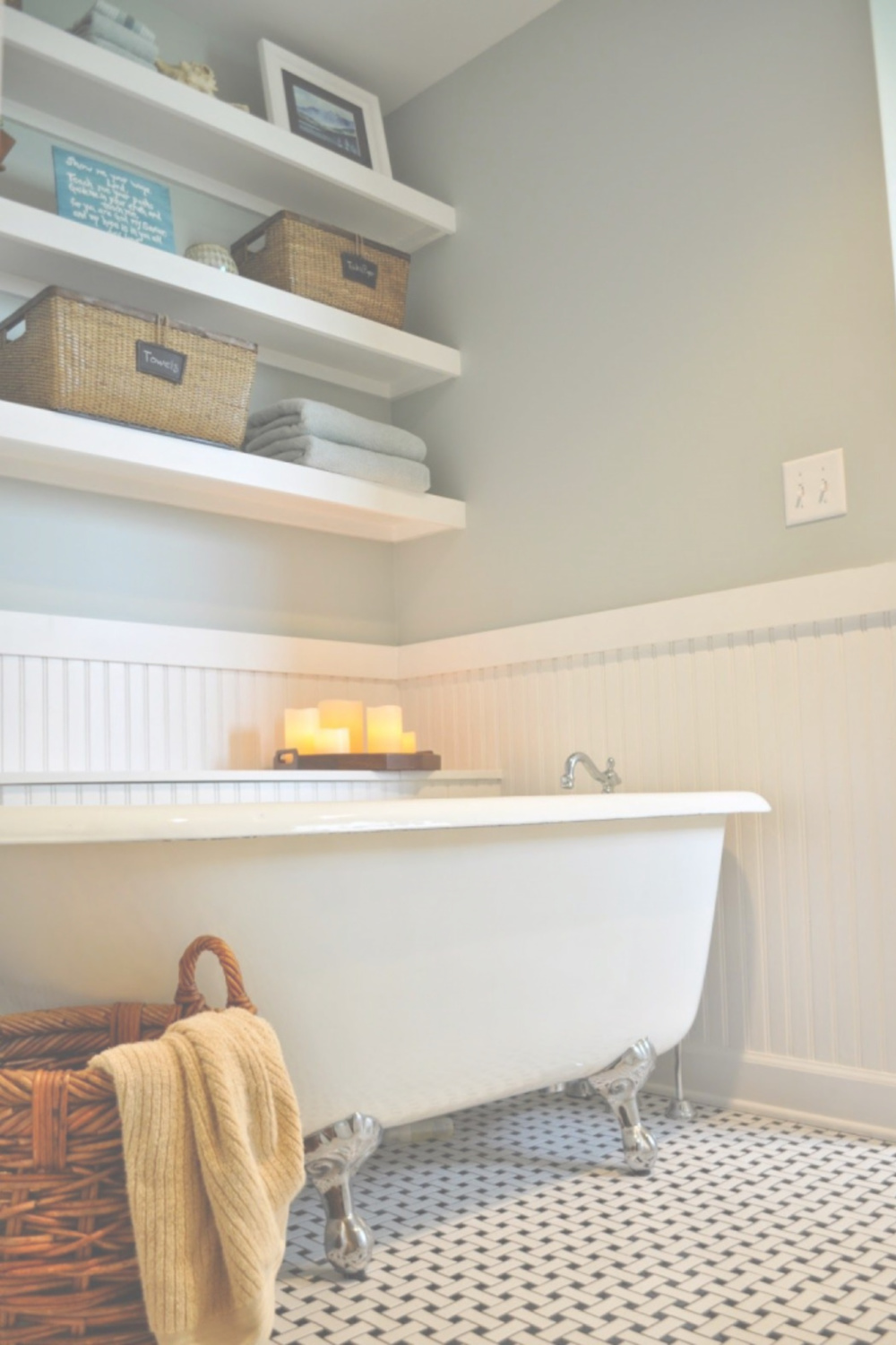 Beautiful pale blue walls in a bathroom with clawfoot tub - paint color is Quiet Moments by Benjamin Moore. #quietmoments #benjaminmoorequietmoments #paleblue