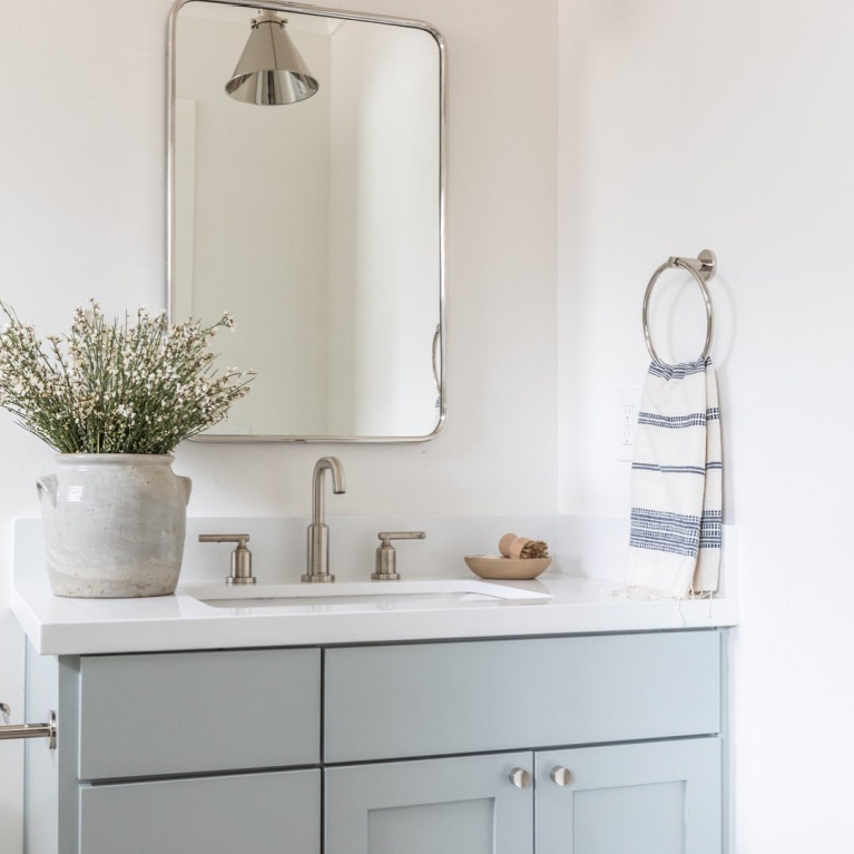 Light blue bathroom vanity painted Quiet Moments (Benjamin Moore) - @evalarocqueinteriors. #quietmoments #paintcolors #vanity #bluebathroom
