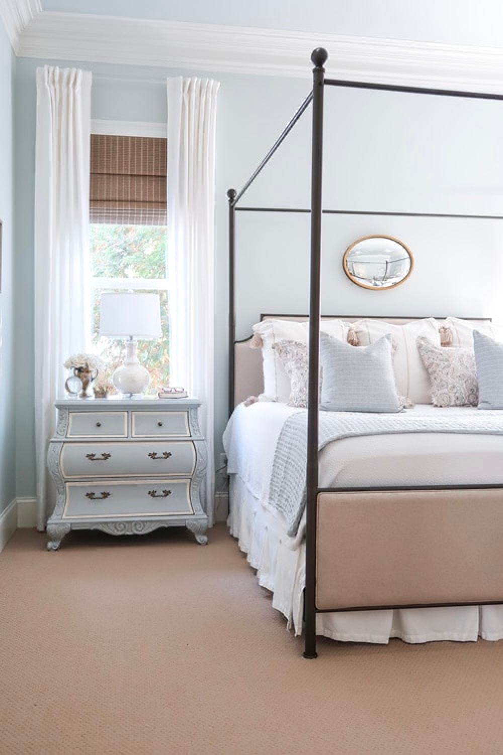 Pale blue bedroom walls painted Quiet Moments (Benjamin Moore) with poster bed and French nightstand - Porchdaydreamer. #quietmoments #benjaminmoorequietmoments #paleblue #bluebedroom