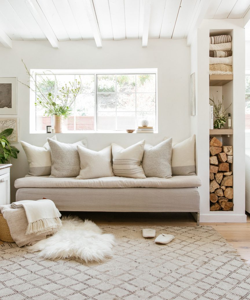 Jenni Kayne arctic sheepskin in a gorgeous natural rustic luxe space with built-in.