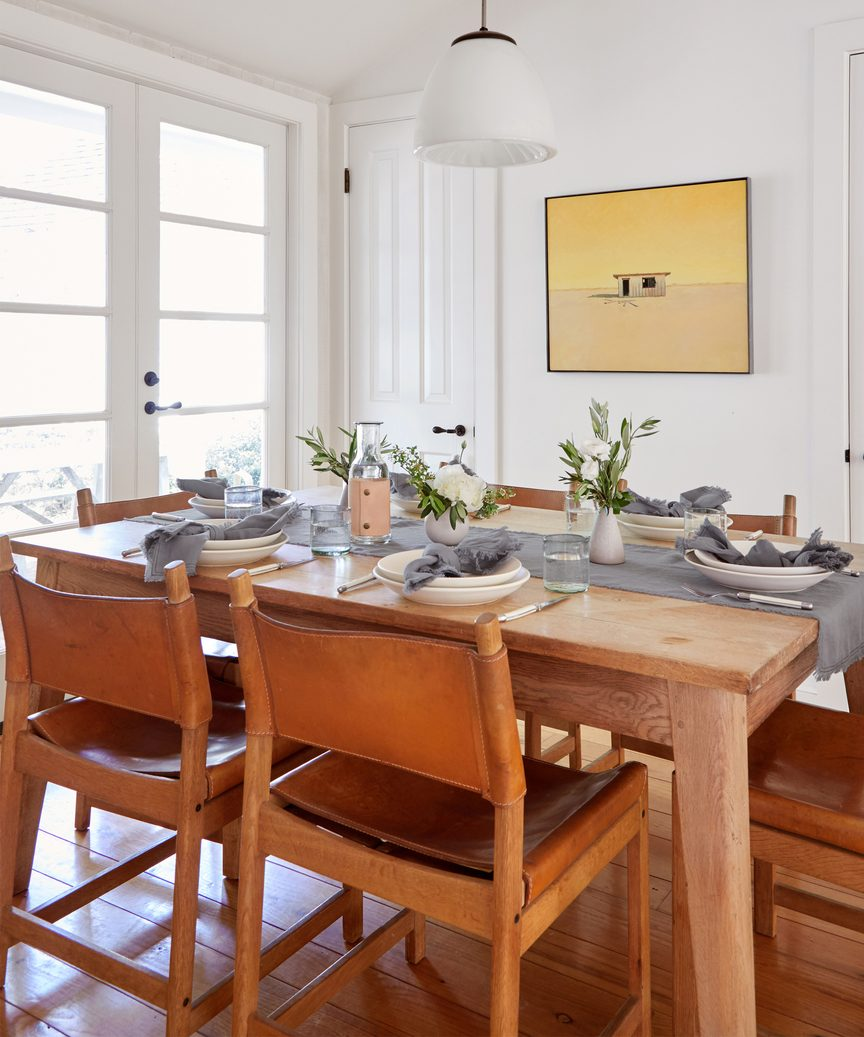 Jenni Kayne frayed linen runner on a minimal design dining table.