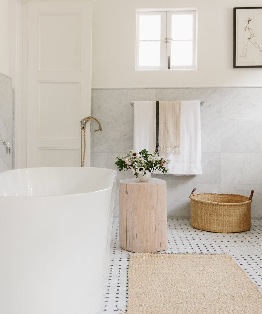 Lack back Cali organic natural luxe bathroom by Jenni Kayne with nesting basket.