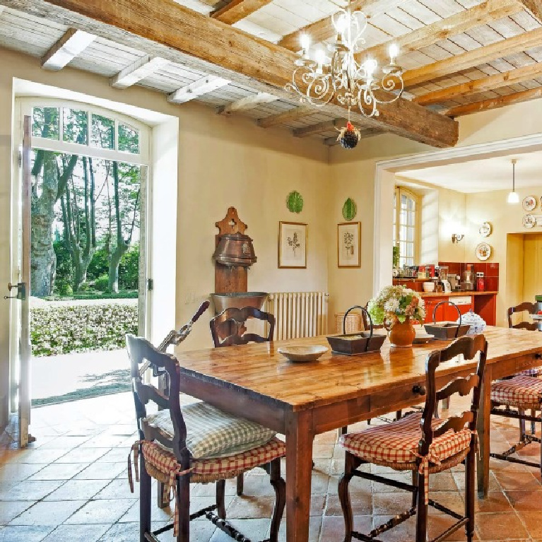Elegant French kitchen and dining room with wood ceiling and terracotta tiled floors in a breathtaking Provence vacation villa - Haven In.