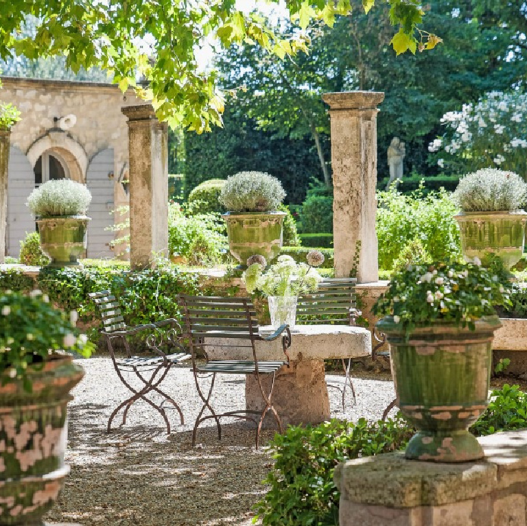French formal gardens and courtyard with pea gravel - see more of this Stunning French Château Near St-Rémy-de-Provence by Haven In. #frenchgarden #frenchcourtyard #frenchchateau