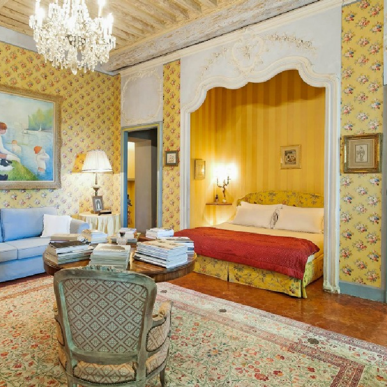 Bright and cheerful traditional style French country colors of blue and yellow in a stunning bedroom with crystal chandelier in a Provence chateau - Haven In.