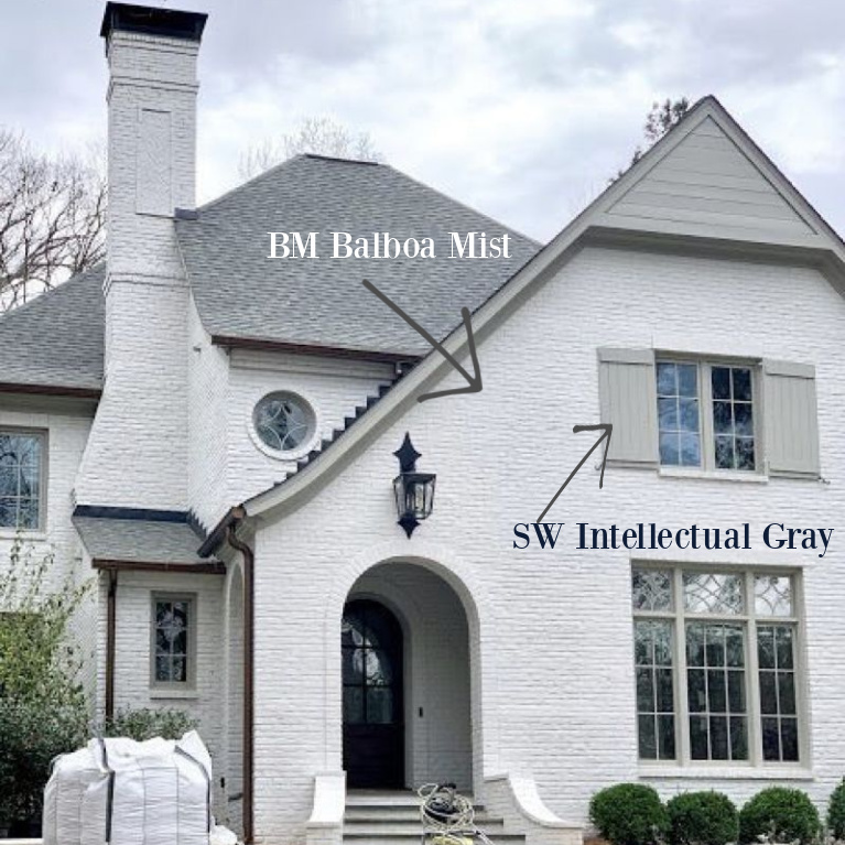 Balboa Mis (Benjamin Moore) paint color on brick exterior of house and Sherwin-Williams Intellectual Gray on trim and shutters. #paintcolors #balboamist #intellectualgray