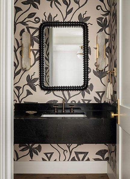 Lovely black graphic wallpaper in a bathroom with design by Brian Paquette.