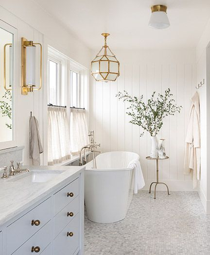 Beautiful classic white bath with freestanding tub - from AT HOME by Brian Paquette (Gibbs Smith, 2021). #bathroomdesign