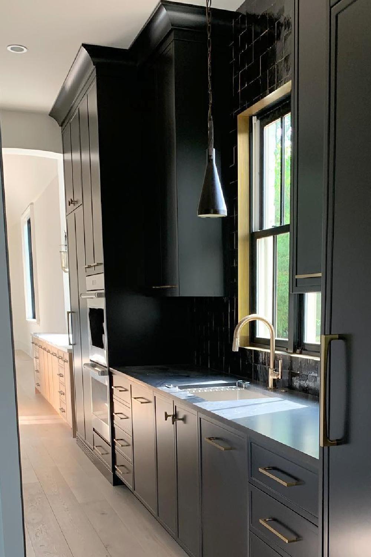 Sherwin-Williams Tricorn Black in a kitchen butler pantry - Ladisic Fine Homes & Matthew Quinn. #tricornblack #blackpaintcolors #blackkitchens #sherwinwilliams