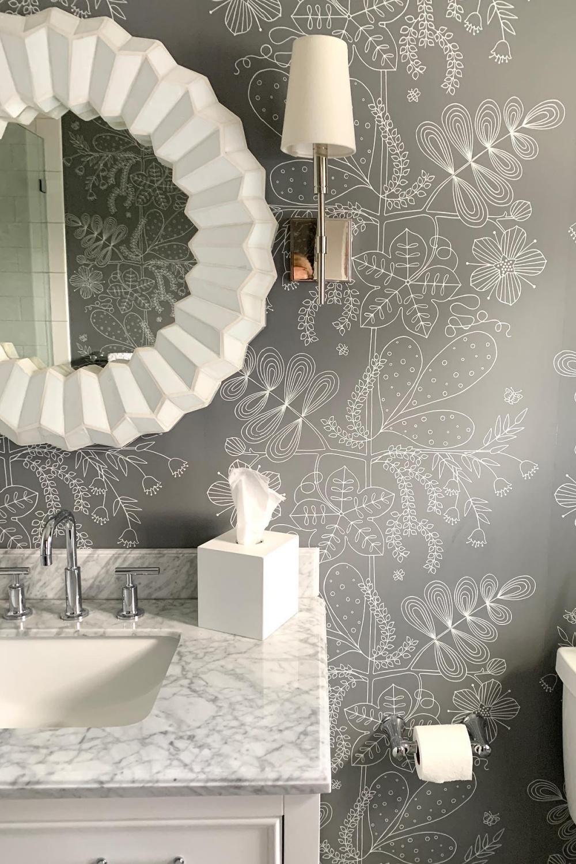 Gorgeous Schumacher grey wallpaper in a powder room with design by Sherry Hart. #interiordesign #powderroom #bathrooms #wallpaper