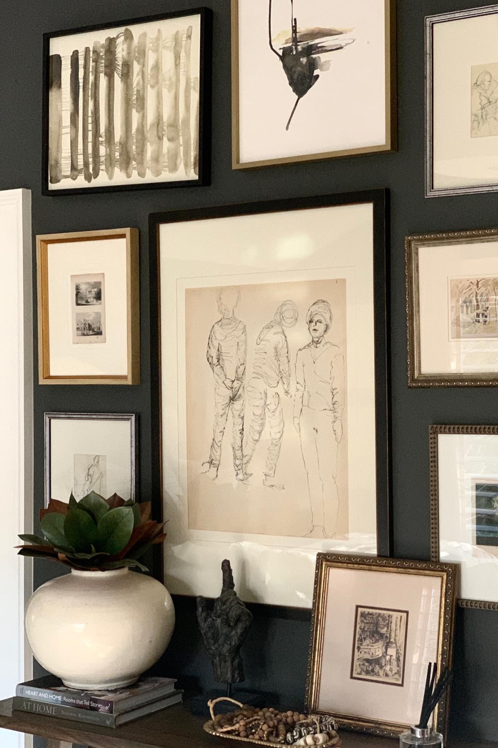 Gorgeous gallery wall painted Benjamin Moore Iron Mountain provides a lovely contrast with framed art with white mats - Sherry Hart. #benjaminmoore #ironmountain #paintcolors