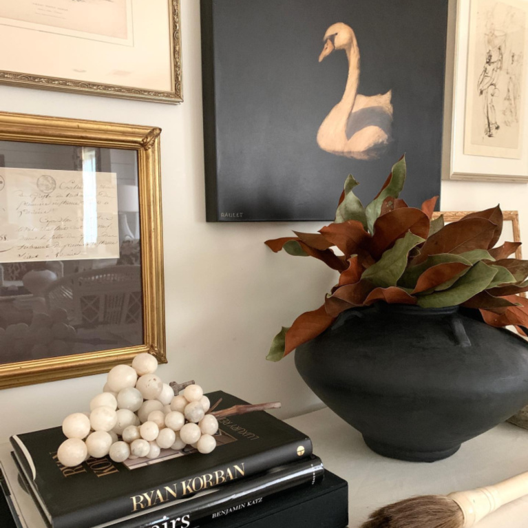 Gorgeous gallery wall and styled vignette by Sherry Hart. #interiordesign #gallerywall #blackandwhite