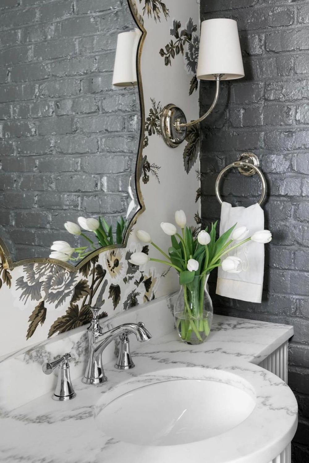 Grey painted brick and Schumacher wallpaper in a lovely classic bathroom with design by Sherry Hart. #pynehollyhock #wallpaper #bathroom