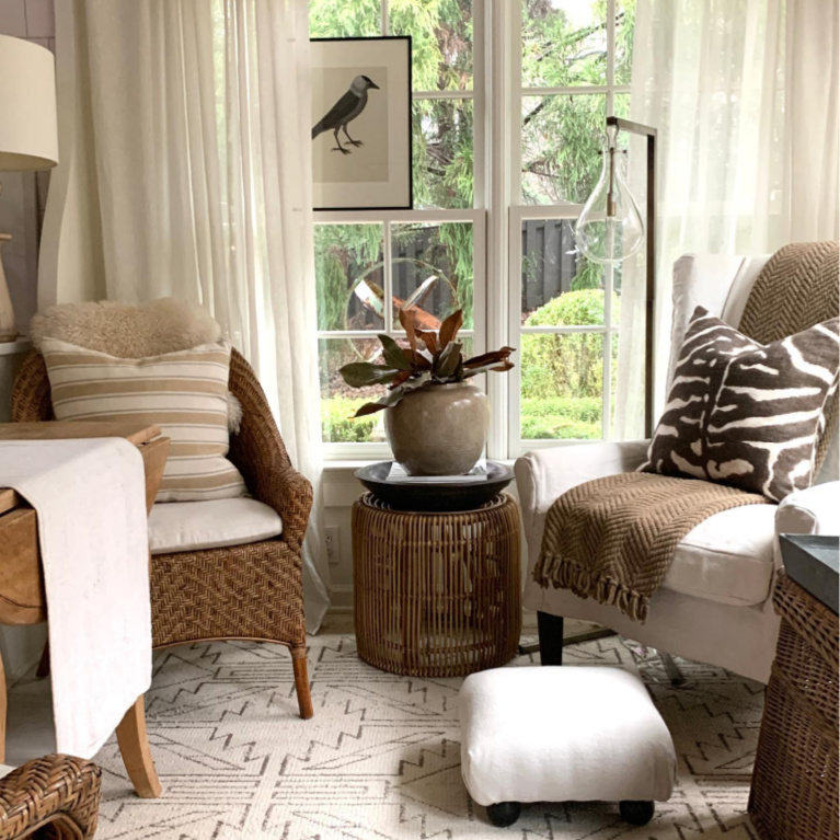 Keeping room with lovely woven chairs and neutrals - Sherry Hart.