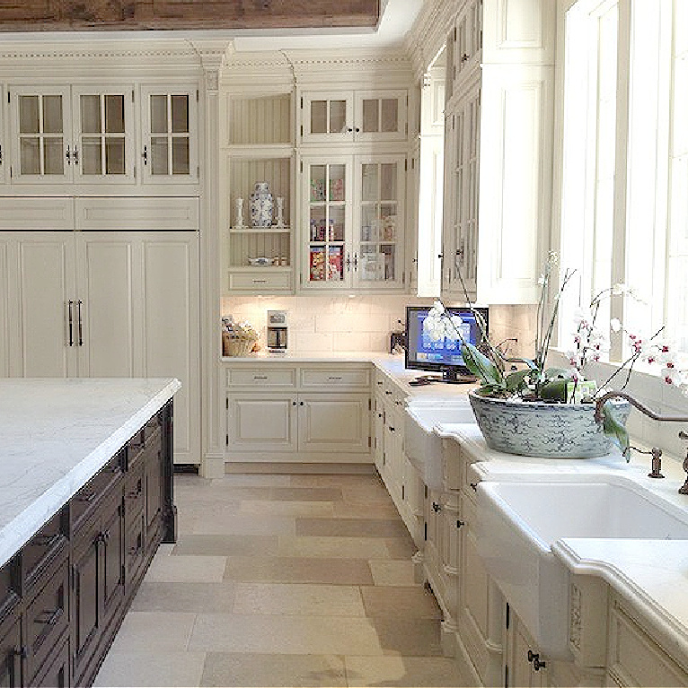 Image result for enchanted home Tina's kitchen with white cabinetry, stone floors, and calacatta gold marble