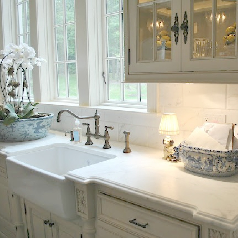 Image result for enchanted home Tina's kitchen with calacatta gold mrable countertop, farm sink, and glass front French Country cabinets
