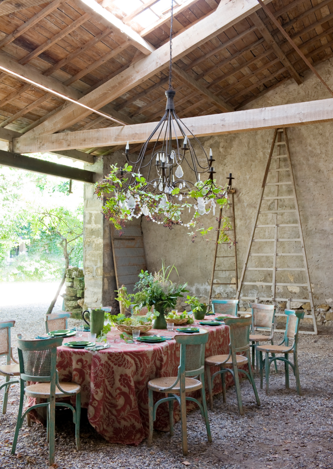 Covered outdoor dining space in Provence with chandelier and rustic wood rafters. Featured in Shauna Varvel's PROVENCE STYLE. #interiordesign #frenchcountry #oldworldstyle