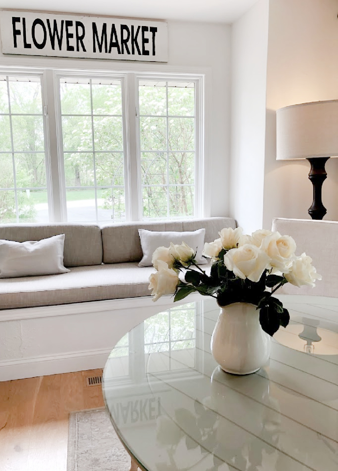 White roses in a vintage ironstone pitcher in my kitchen with window seat - Hello Lovely. #whiteroses #whitedecor #windowseat #breakfastnook