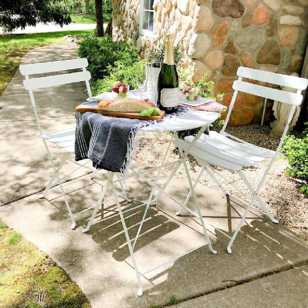 White Parisian style cafe dining set is perfect for small spaces and casual dining when you love a little romance - Hello Lovely.