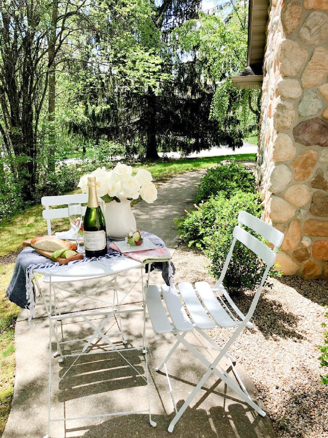 Charmingly French country and rustic casual dining outdoors with white cafe chairs - Hello Lovely Studio. #outdoordining #frenchaesthetic #countryfrench