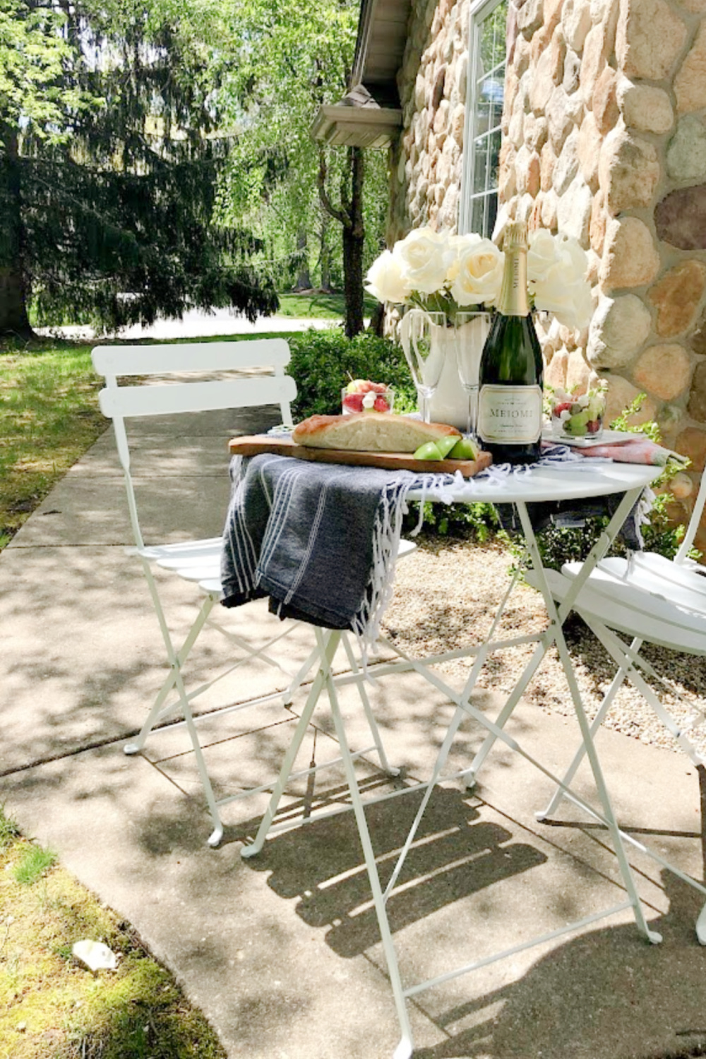 Rustic French country cafe dining in the garden with white roses on the table - Hello Lovely Studio. #frenchcafe #frenchcountry #bistroset #cafeset