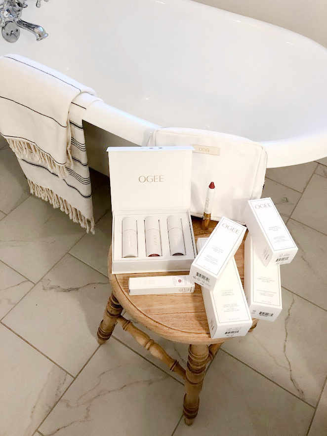 OGEE skincare and makeup goodies in their exquisite white and gold chic packaging in my bathroom ready to sample - Hello Lovely Studio. #ogee #beautyover50 #skincare