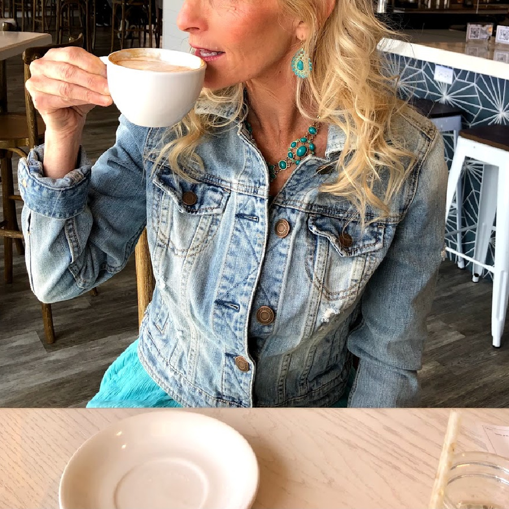 Michele of Hello Lovely in denim jacket sipping espresso at brunch at The Hampton Social in South Barrington. #hamptonsocial #thehamptonsocial