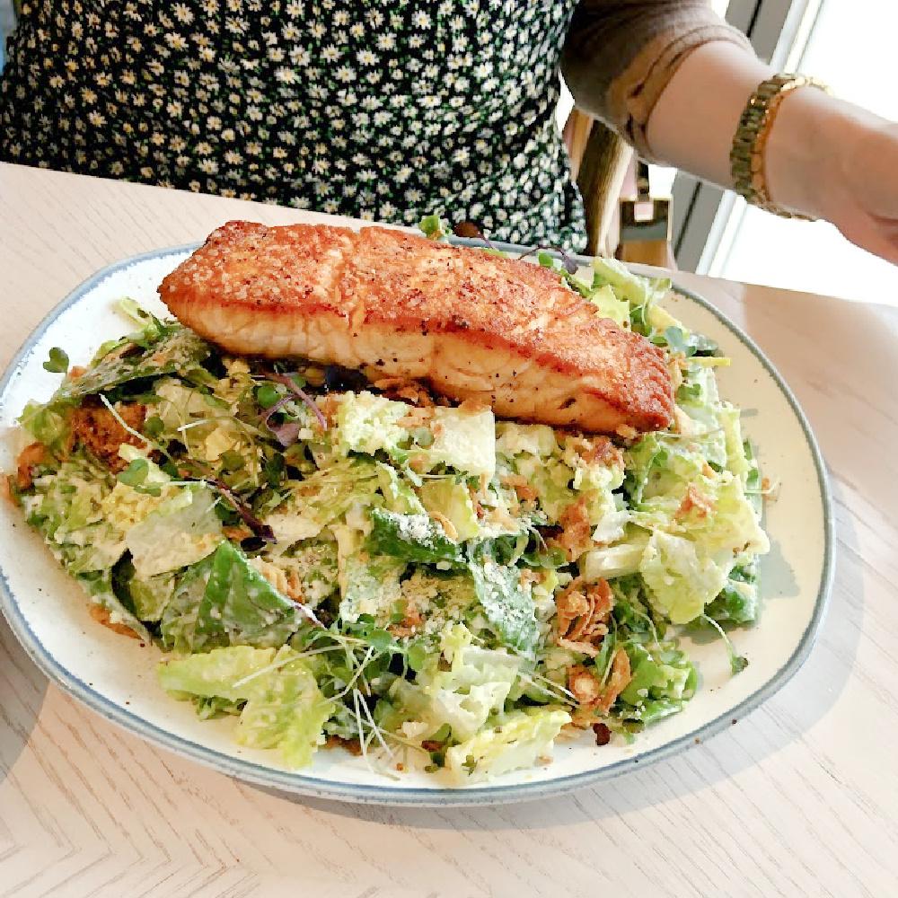 Caesar salad with salmon at Hampton Social in South Barrington - Hello Lovely Studio. #hamptonsocial #caesarsalad #thehamptonsocial #brunchfood
