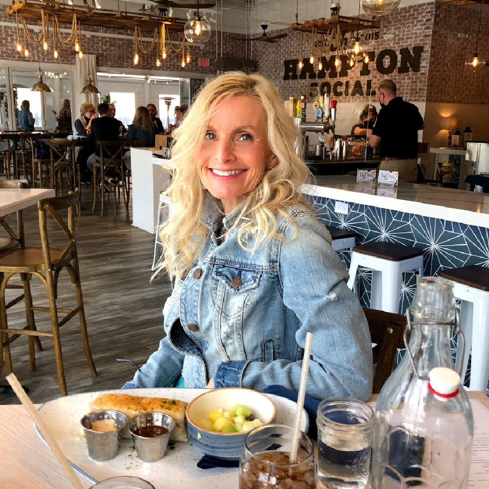 Michele of Hello Lovely in denim jacket at The Hampton Social in South Barrington for brunch. #thehamptonsocial #hamptonsocial