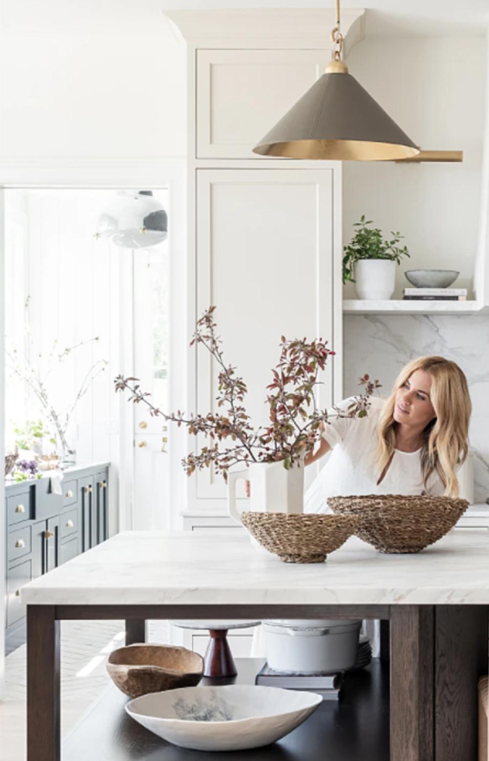 Beautiful classic modern farmhouse white kitchen island with wood open shelves beneath - McGee & Co. #whitekitchens #modernfarmhosue #serenekitchens