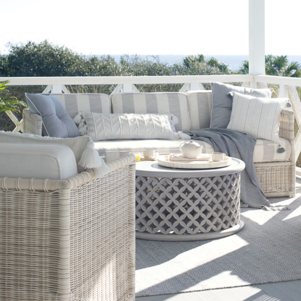 Serena & Lily Pacifica outdoor coastal style furniture with light grey on a lovely veranda.