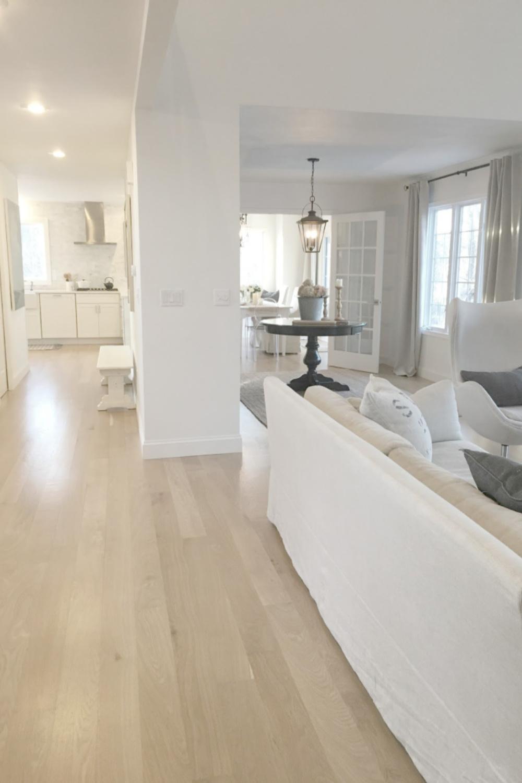 Hello Lovely Studio's white oak hardwood floors in her European country living room, dining, and kitchen with Belgian linen. #hellolovelystudio #interiordesign #whiteoak #hardwoodfloors #belgianlinen #europeancountry #openfloorplan