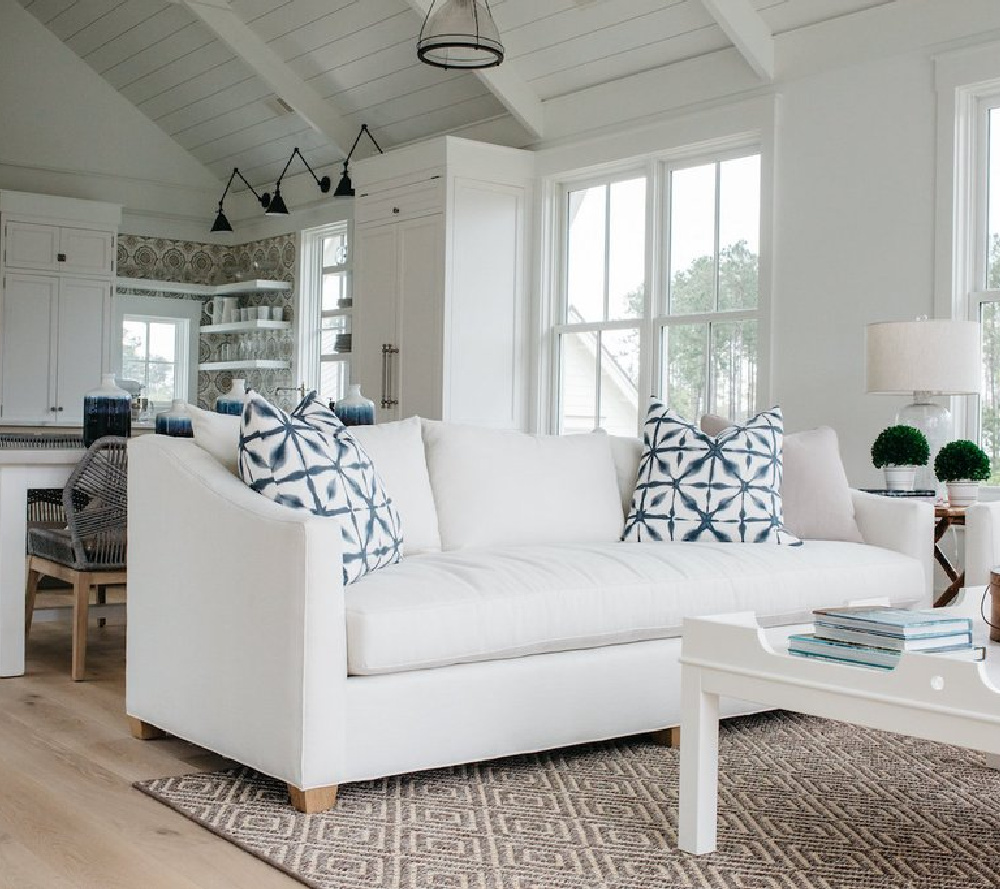 White great room in a board and batten coastal cottage in Palmetto Bluff with modern farmhouse interior design by Lisa Furey.