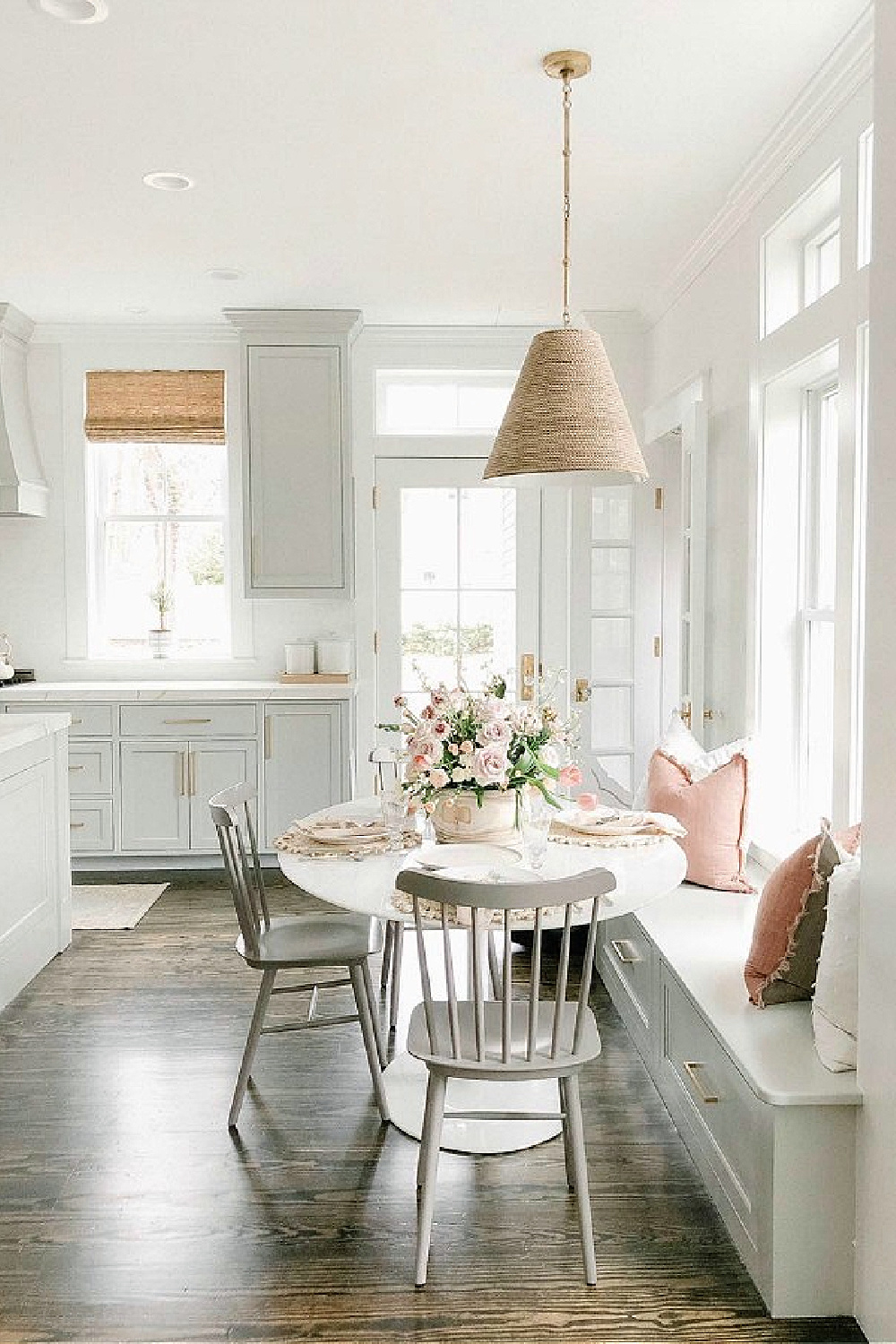 Timeless and classic grey and white kitchen by Finding Lovely with its window seat breakfast nook and pink accents!