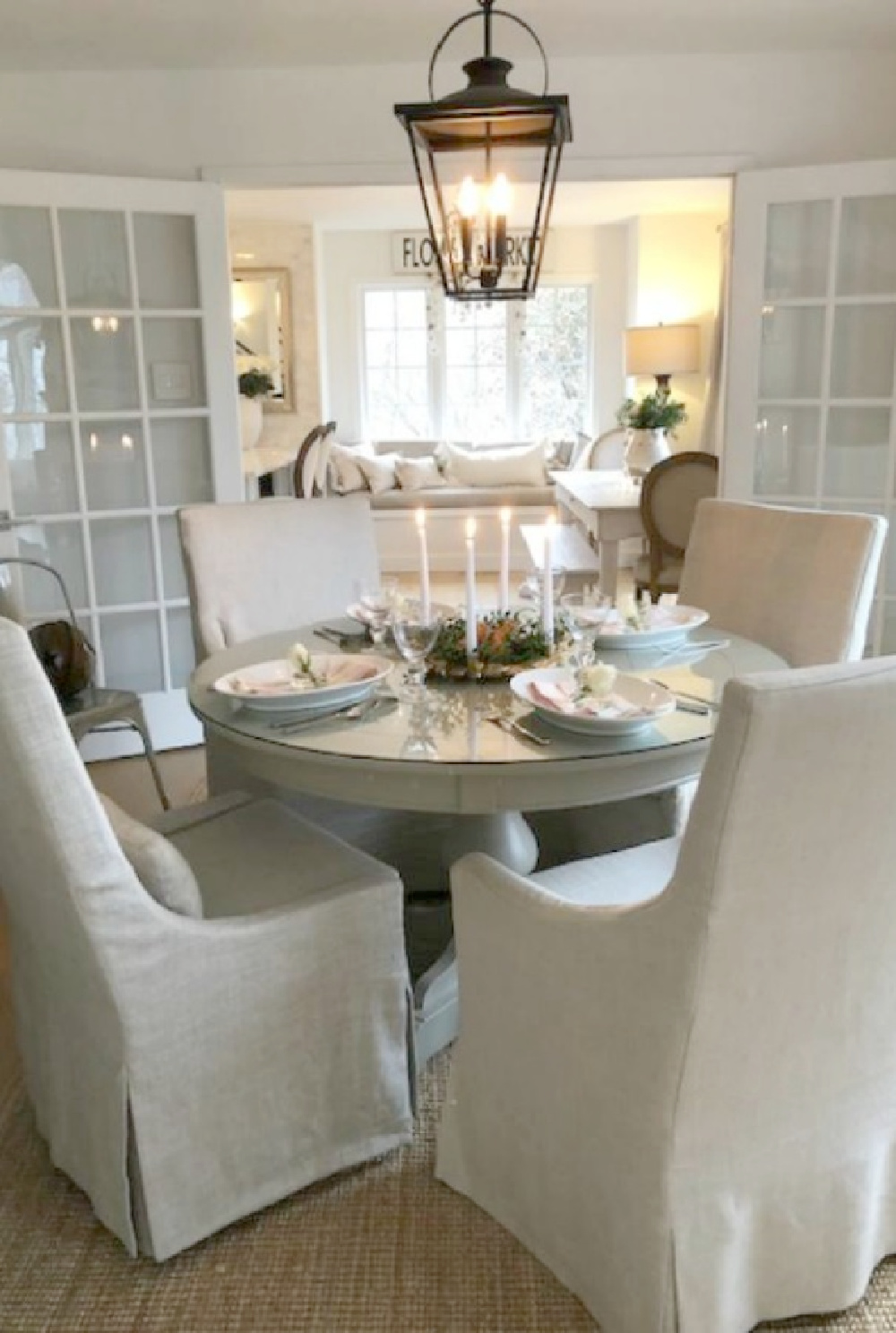 Belgian linen arm chairs around my round dining table - Hello Lovely Studio.