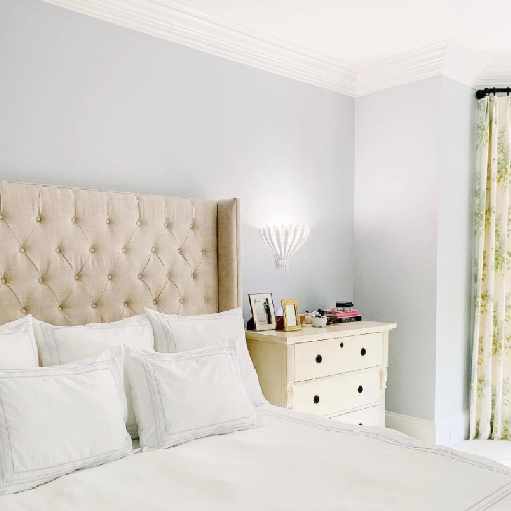 Borrowed Light paint color (Farrow & Ball) in a pretty bedroom with tufted wing headboard - Melissa Richman @embeerich. #borrowedlight #bluepaintcolors