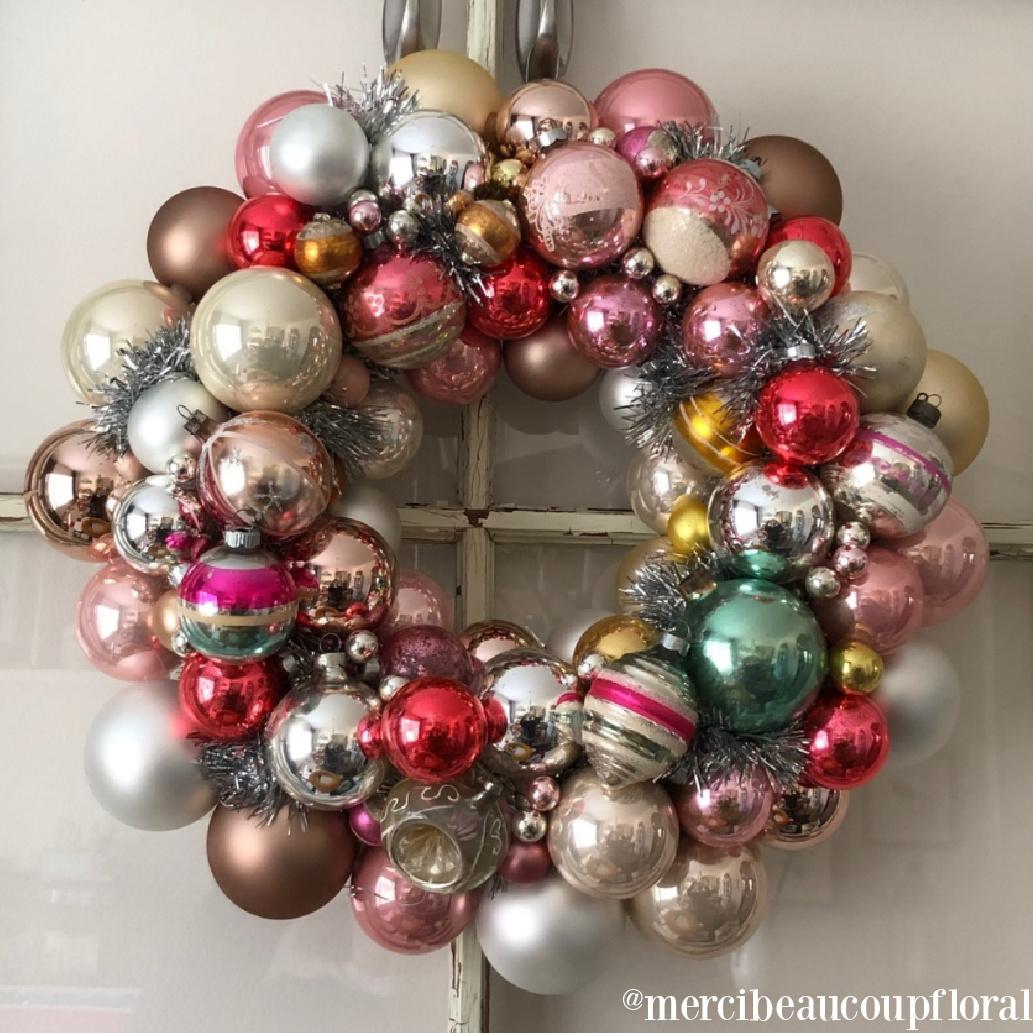 Christmas wreath with colorful glass ornaments - Merci Beacoup Floral. #christmaswreaths #vintagechristmas #ornamentwreath