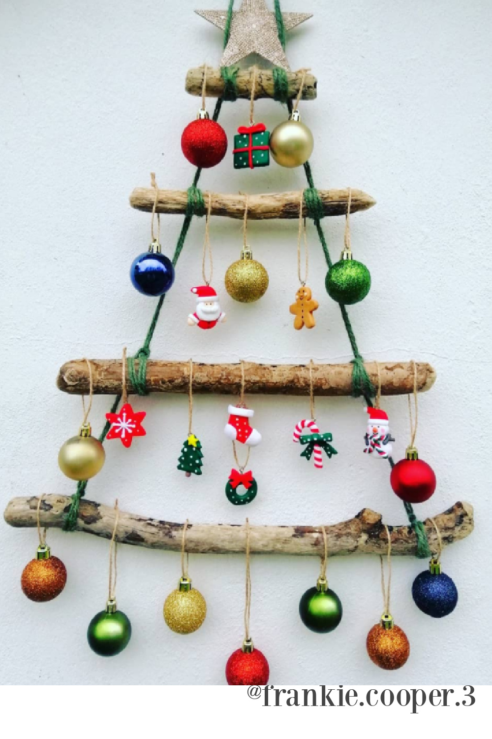 Driftwood Christmas tree with colorful ornaments - @frankie.cooper. #driftwoodtree #christmastrees