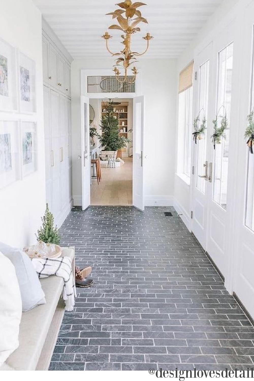 Elegant Christmas decor in an entry with brick tile - Design Loves Detail. #christmasdecor #elegantchristmas